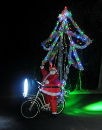 Santa with Xmas tree and World's brightest bike lights